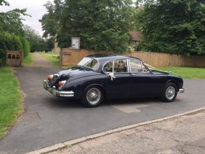 Jaguar Mk2 In Blue with silver chrome wheels