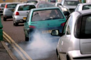 Dirty Exhaust fumes coming from the rear of a diesel car in traffic