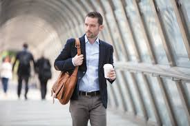 Man drinking coffee on the way to work