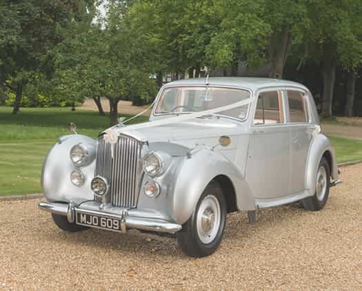 Image of a light silver Bentley MK V1.