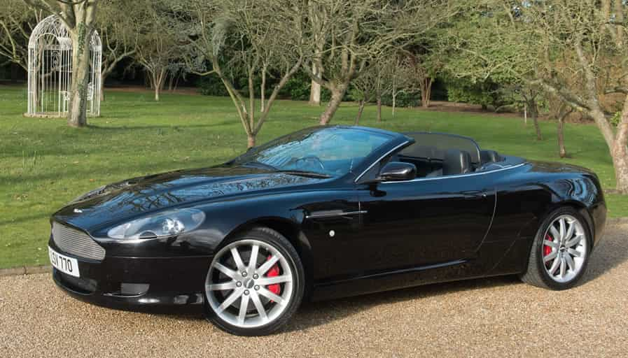 Image of a dark grey Aston Martin DB9 volante convertible