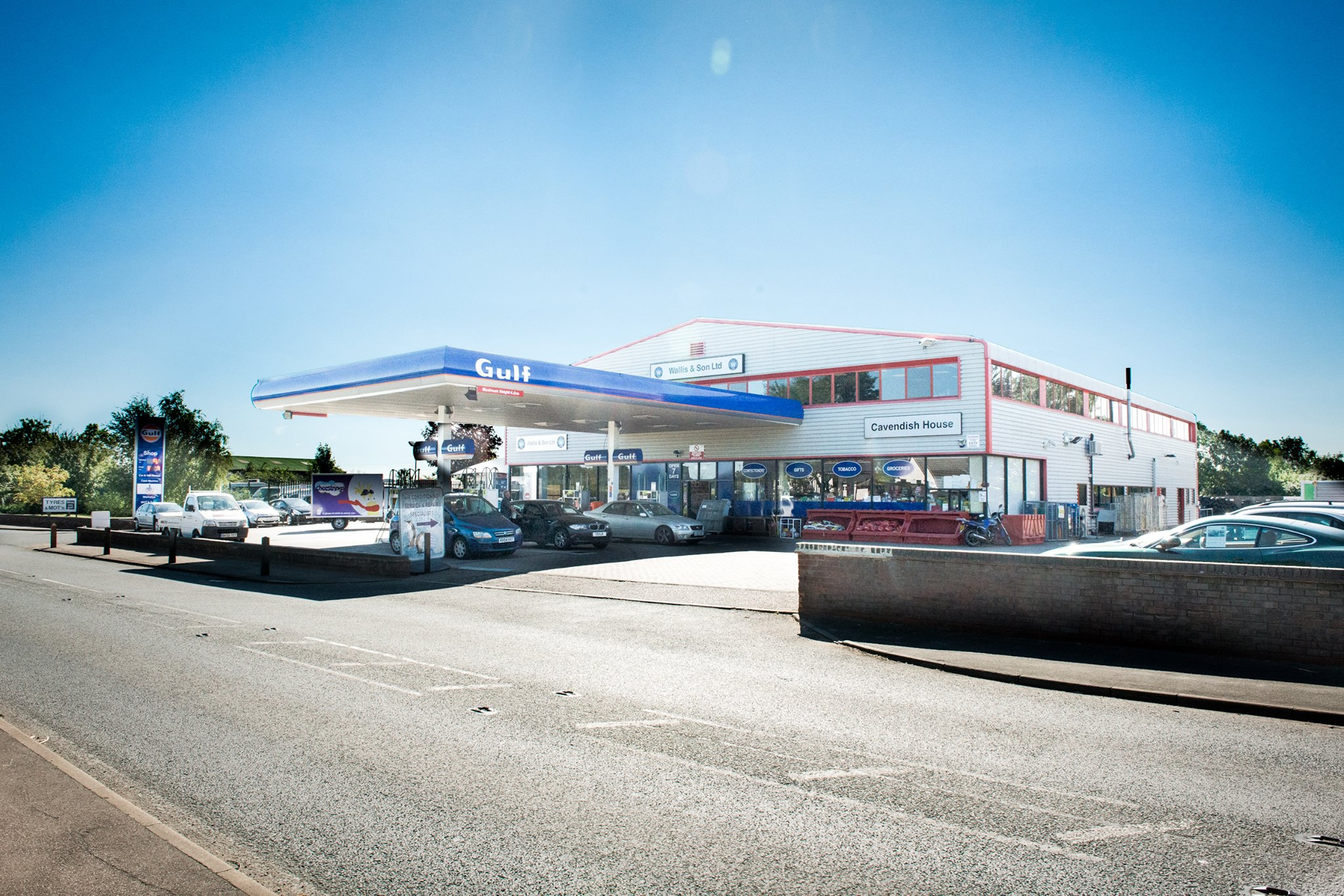An image of the Wallis & Son forecourt filling up station